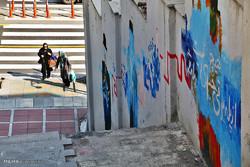 دیوار بلند«گرافیتی»در رودخانه خشک/ بومی به اندازه دیوارهای شهر