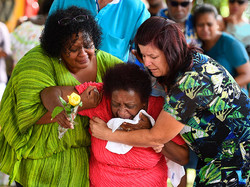 460733466-family-members-mourn-at-the-scene-of-a-gettyimages(1).jpg