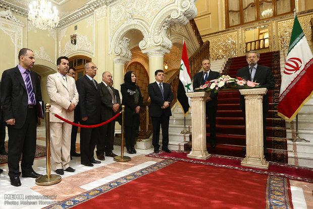 لقاء رئيسي البرلماني الايراني والسوري