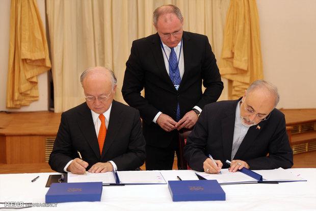 التوقيع على خطة العمل المشترك بين منظمة الطاقة الذرية الايرانية والوكالة الدولية للطاقة الذرية