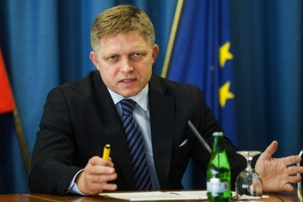Slovakia opposes migrant quotas, vows to sue EU