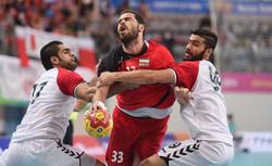 Handball players bag 1st victory at Asian champs.