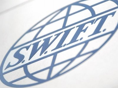 SWIFT open to four more Iranian banks