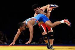 Iranian wrestlers enjoy golden night in Paris