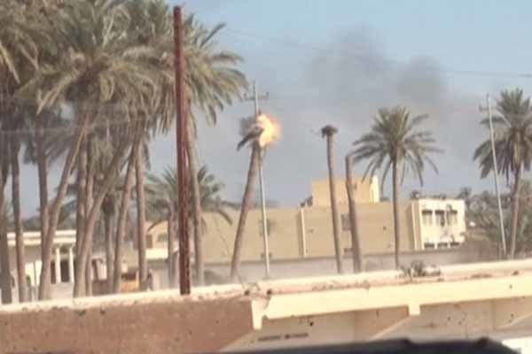 VIDEO: Iraqi snipers fire at ISIL flags