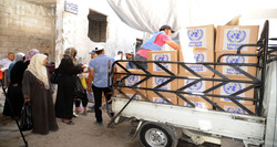 Food packages distributed to displaced locals of Yarmouk Camp