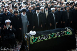Leader leads prayers on body of Ayat. Vaez Tabasi