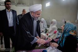 Rouhani visits nursing, veterans homes in Tehran