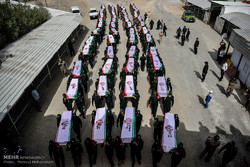 Bodies of 55 sacred defense martyrs arrive home
