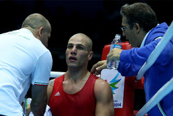 Iranian boxer bitterly loses Olympic bout