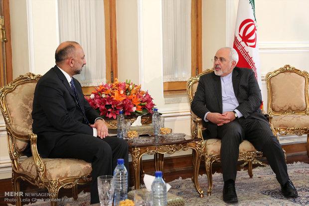 Zarif, Afghan natl. security adviser meet
