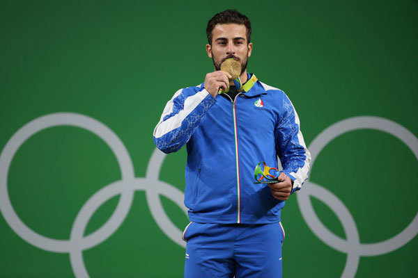 Iran Weightlifter Auctions Gold Medal for Earthquake Victims