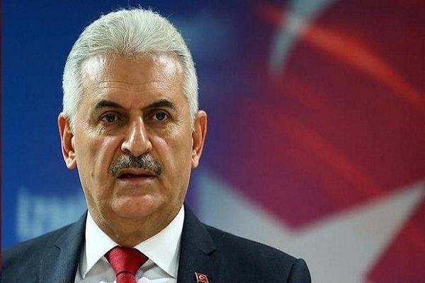 رئيس الوزراء التركي: الأسد يمكن أن يبقى رئيسا مؤقتا