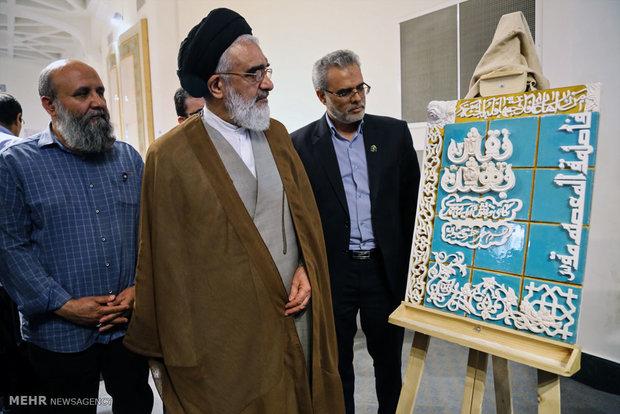 حجتالاسلام سید محمد سعیدی و مسعود نجابتی در کارگاه پوستر نقش بهشت