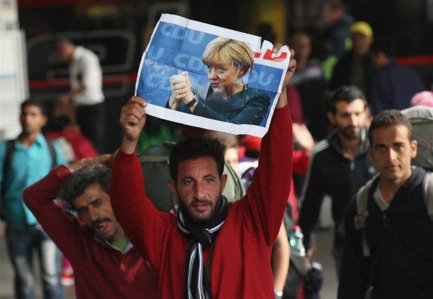 Merkel under fire over 'open-door' refugee policy