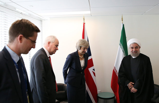 Iran's Rouhani (R) in a meeting with British Prime Minister Theresa May (M) on Tuesday on the sidelines of the 71st United Nations General Assembly in New York.