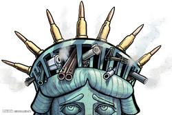 کاریکاتور؛ تیراندازی پلیس آمریکا به سیاهپوستان
