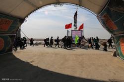 پرچم متبرک بارگاه اباعبدالله در شلمچه به اهتزاز در آمد