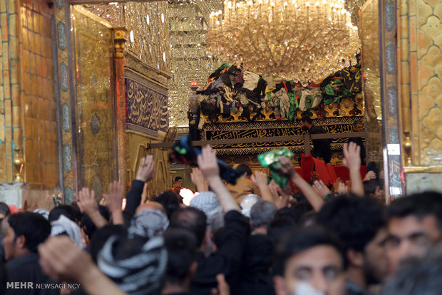 Karbala; Shrine of Imam Hussein embraced by swarms of pilgrims