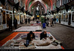 Men darn Persian carpets in the Tabriz bazaar complex