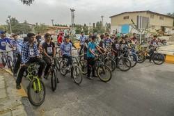 مسابقه دوچرخه سواری روز نیروی دریایی در خارگ برگزار شد