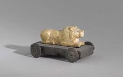 Prehistoric animal figurine mounted on little carriage