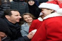 بشار الأسد وزوجته يحتفلان بعيد الميلاد بمدينة صيدنايا