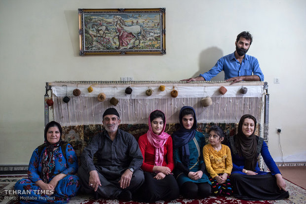 Family members of one of Hosseini's trainees posing in front of the camera.