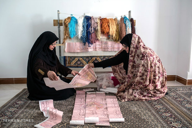 Hosseini is following up on the improvements of a carpet her trainee is weaving ordered by England.