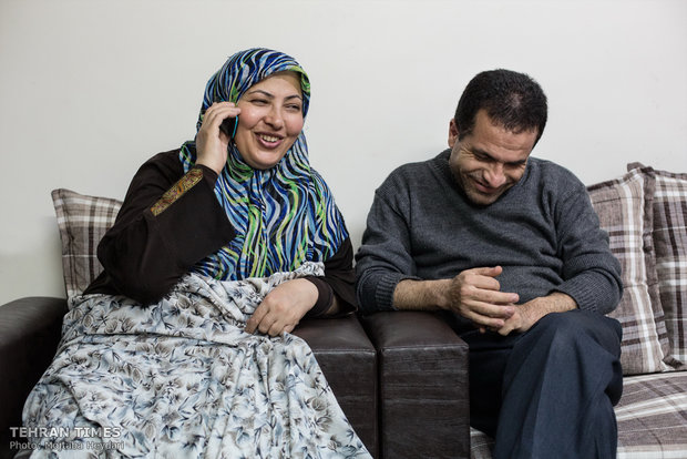 Sitting next to her husband, Hosseini is talking on the phone with her mother who lives in Bijar.