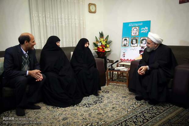 Pres. Rouhani visits martyrs' families