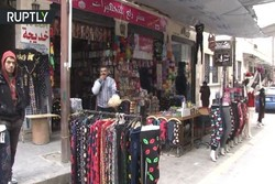Aleppo's main shopping area reopens after liberation