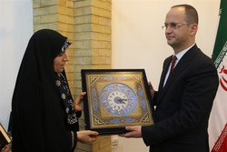 Iran's Cultural Heritage, Tourism and Handicrafts Organization Director Zahra Ahmadipour (L) presents a gift to the visiting Minister of Foreign Affairs of the Republic of Albania Ditmir Bushati durin