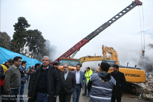 Rouhani visits building collapse site