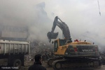 Plasco still in smoke with bodies trapped