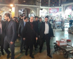 French Foreign Minister Jean-Marc Ayrault pays a visit to the historical grand bazaar in downtown Tehran on February 1, 2017.