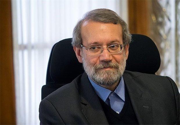 Larijani, Ghasemi praise national wrestling champions