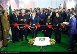 CHTHO Director Zahra Ahmadipour (3rd R) and Minister of Culture and Islamic Guidance Reza Salehi-Amiri (3rd L) are about to cut the ribbon on the 10th Tehran International Tourism Exhibit on February