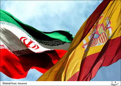 Iranian and Spanish national flags flatter in an undated photo.
