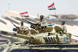 Armed Iraqi factions threaten to target Americans in response to travel ban