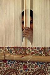 A handwoven Baluchi carpet