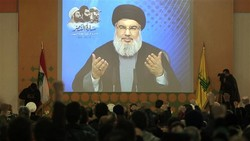 Leader of Lebanon's Hezbollah resistance movement, Sayyed Hassan Nasrallah, is seen speaking through a video link during a ceremony in Teir Debba village, southern Lebanon, February 16, 2017. (Photo b
