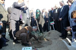 Iranian, foreign officials plant memorial tree in Tehran