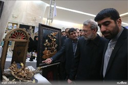 Iranian Majlis Speaker Ali Larijani (2nd from R) visits a handicrafts exhibit at the parliament premises in Tehran on March 4, 2017.