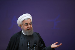 Faith more important than weapons against enemies: Rouhani