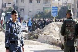 انطلاق عملية خروج المسلحين من حي الوعر في حمص