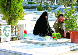 Iranians pay respect to the graves of soldiers who were killed during the 1980-88 Iran-Iraq war, in Mashhad. (Photo: Ahmad Halabisaz/Xinhua Press/Corbis)