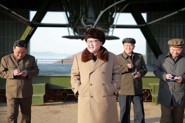 Kim Jong watches ground jet test of new high-thrust engine