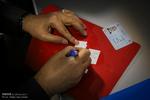İran'daki seçim kayıtlarından kareler