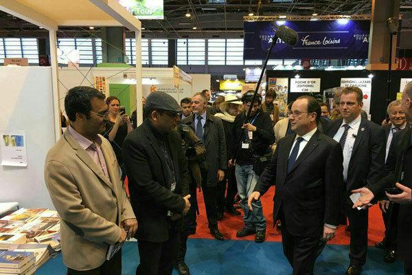 François Hollande visits Iran's pavilion at Paris Book Fair